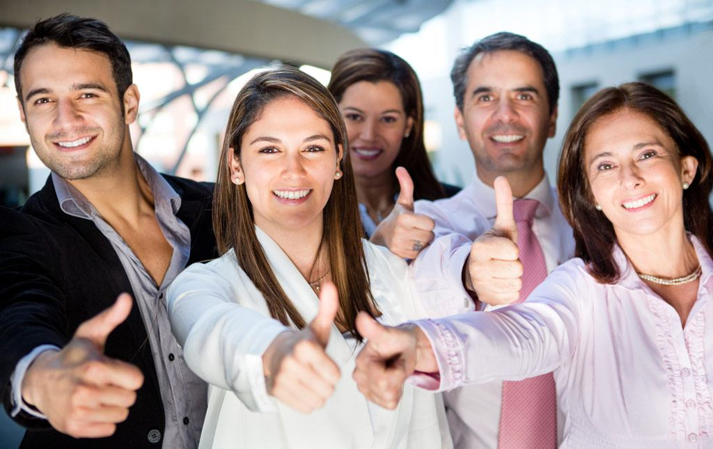 Happy business team with thumbs up and smiling